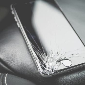 an iphone with a cracked display