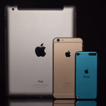 an ipad, iphone and ipod standing next to one another